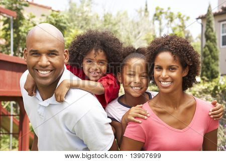Portrait of Happy Family In Garden