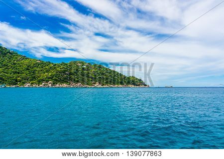 Sea With Rock Mountain Blues Sky Background
