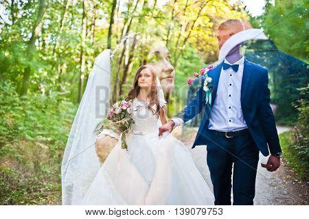 Multiexposition photo of wedding couple  at wedding