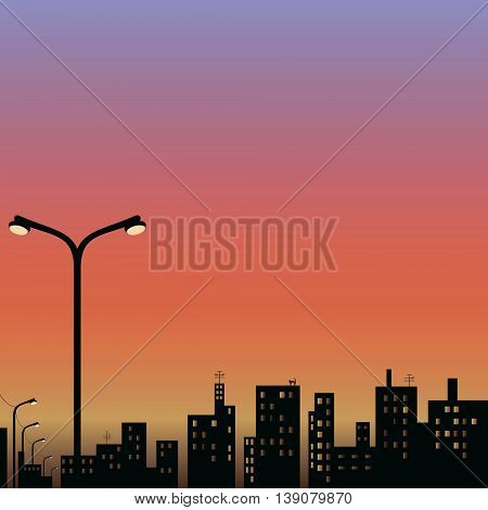 view of the city at night with street lamp in the foreground on the Sunset