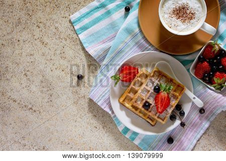 Traditional Belgian Waffles With Fresh Berries On The Stone Brown Background, Served With A Cup Of C