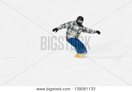 Snowboarder at high speed down the mountainside