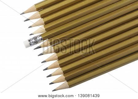 Graphite pencils of golden color on white background