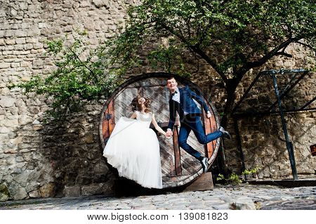 Wedding Couple Having Fun And Jumping Together
