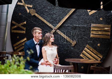 Wedding Couple Sitting Background Big Roman Clock