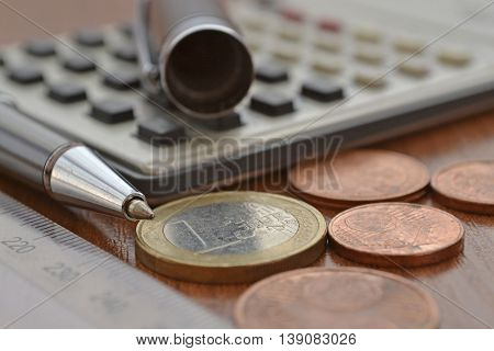 Financial background with money calculator ruler table and pen.