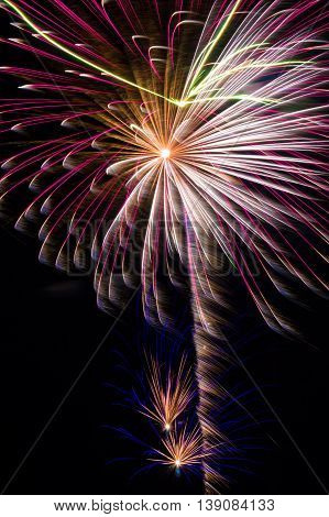 Beautiful fireworks display showering colorful trails overhead.