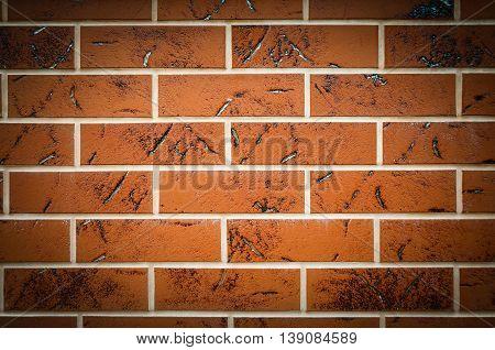 Brown texture tiles under brick background. Wall