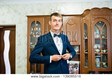Young Groom In His Room Button Buttons On Jacket