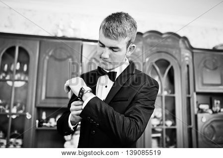 Elegant Young Groom Watching In His Watch