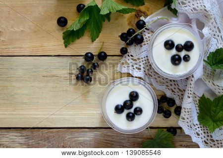 Homemade Yoghurt With A Black Currant On The Table In A Rustic Style, Top View.