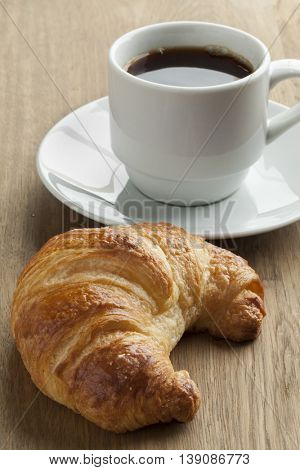 Fresh baked french croissant and coffee for breakfast