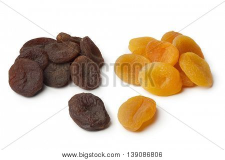 Heap of healthy nutritious brown and orange dried apricot fruit on white background