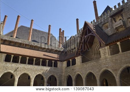 GUIMARAES, PORTUGAL - AUGUST 9, 2016: Medieval arches in an inner patio of Palace of the Dukes of Braganza in Guimaraes in the northern region of Portugal.