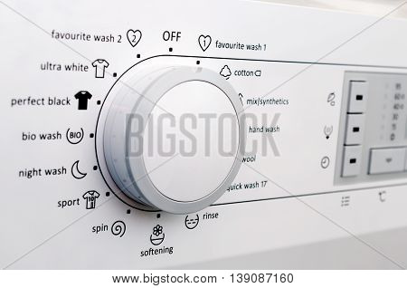 Close up view of washing machine dial and buttons