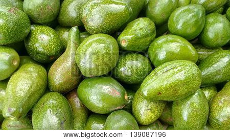 Avocado. Bunch of these delicious green fresh vegetables. Photographed avocados from above.