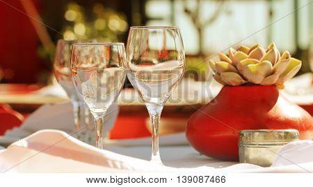 Empty glasses set in restaurant outdoor .