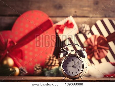 photo of the alarm clock on the christmas decorations background
