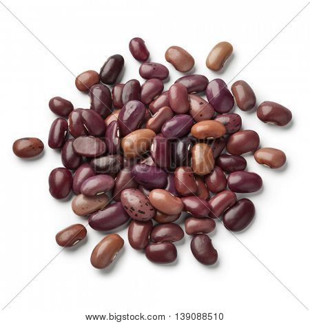 Heap of dried Ayuote Morado beans on white background