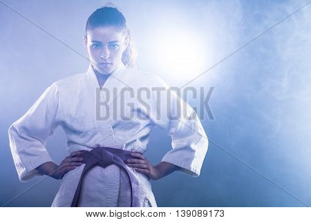 Confident Woman Wearing Karate Kimono with Her Hands on Her Hips