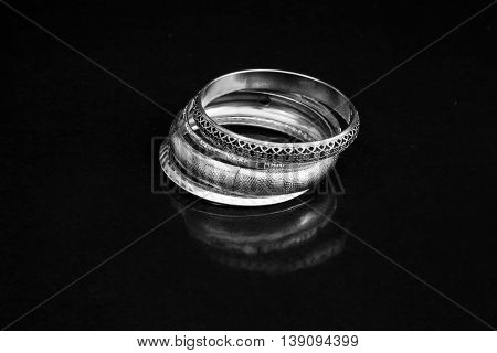 beautiful pair of silver bracelets with black background