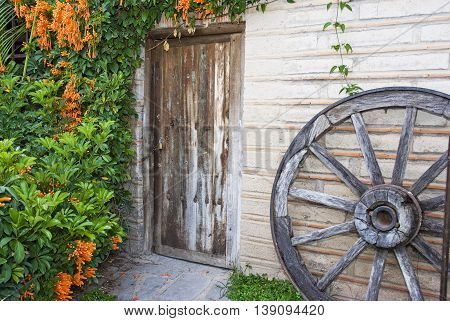 A vintage old wood door and well on the town of Jalisco Mexico America
