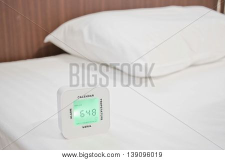 Alarm Clock On White Bed Sheet And White Pillow