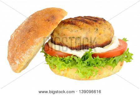 Chicken burger with salad and mayonnaise in a crusty bread roll isolated on a white background