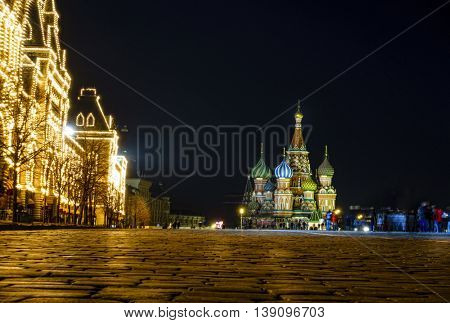 Nighttime view of TsUM Department Store and St. basil Cathedral on the Red Square in Moscow, Russia