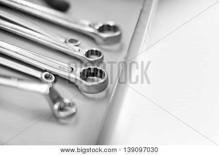 Composition of wrenches on table, cloce up black and white