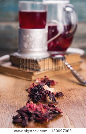hot ruby tea from hibiscus in retro cup on wooden background