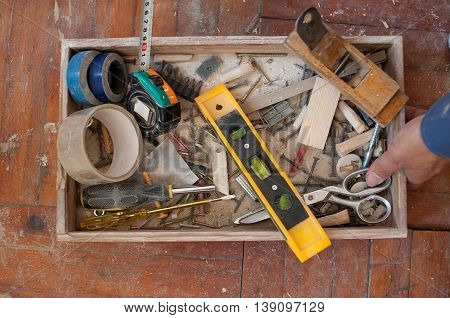 Open the tool box and tool around on the wooden floor, top view.