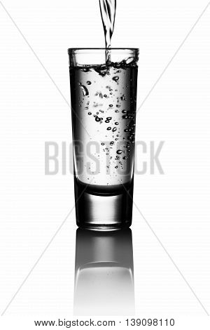 Tequila shot in a mirror isolated on white background