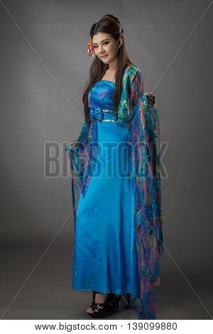Beautiful Asian Model Young Asia Oriental Woman Wearing Chinese Qipao Dress - Studio Shot