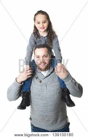 A Father carrying daughter on his shoulders, studio shot