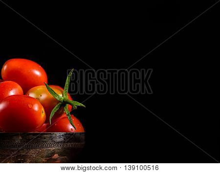 tomato in a silver cup with black copyspace on right