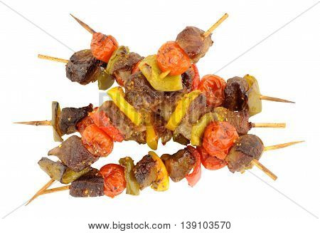 Beef and vegetable kebabs isolated on a white background