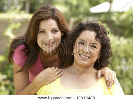 Senior Woman With Adult Daughter In Garden