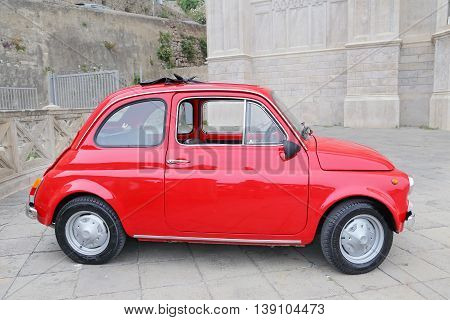 GAETA ITALY - JUNE 25 2016: Fiat 500 on the street in the center of Gaeta. Fiat 500 was produced by the Fiat company from 1957 to 75. New version of the car started production in 2007 Gaeta