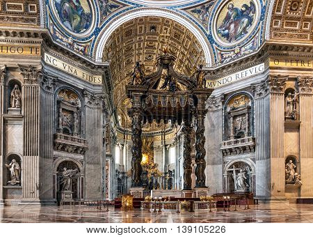 VATICANROME ITALY - JULY 1 2016: Beautiful sculptural decoration on the wall of central nave in interior of the St. Peter's Cathedral. Europe.