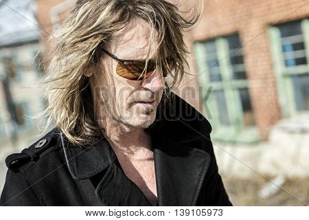 A mature Handsome man in town with grunge style