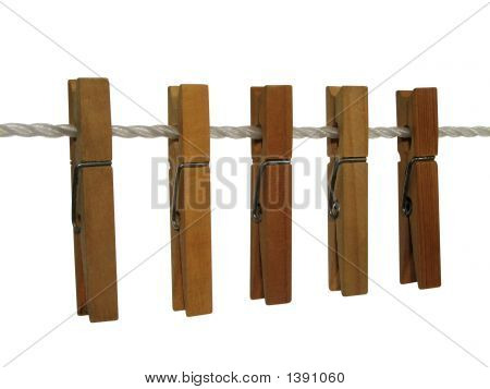 Wooden Clothespins On A Clothes Line (+ Clipping Path)