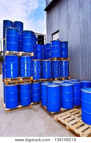 Blue metal fuel tanks of oil stored at the production site.