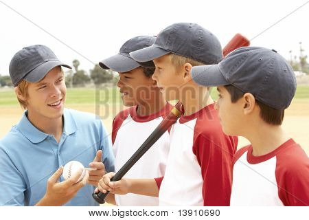 Young Boys In Baseball Team With Coach