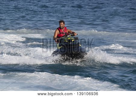 Unidentified Turkish Man Glides Over The Waves Of The Mediterranean Sea On Jet Ski