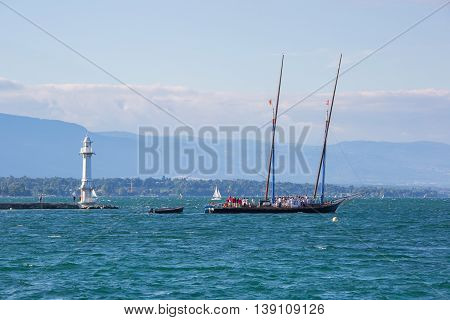 Geneva Switzerland - July 15 2016: The century old Neptune boat leaving the city of Geneva Switzerland.
