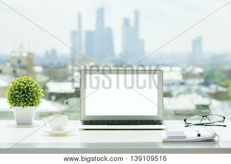 White Laptop On Windowsill