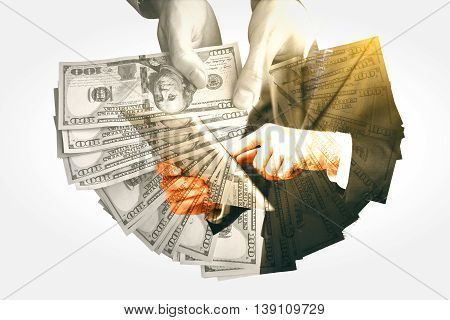 Businesspeople holding dollars and using tablet. Success concept. Double exposure