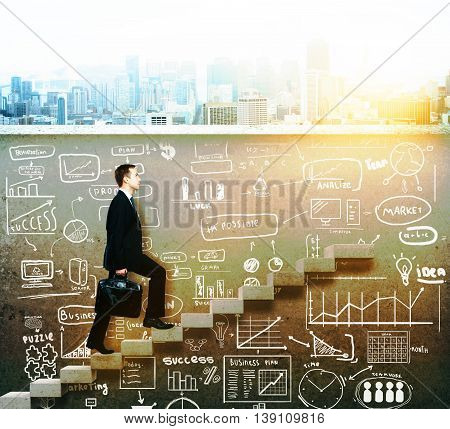 businessman climbing on concrete ladder with business sketch underneath
