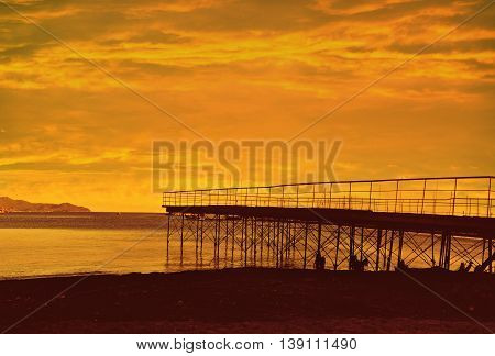 Pier silhouettes with sunset in Santa Margherita Liguria Italy